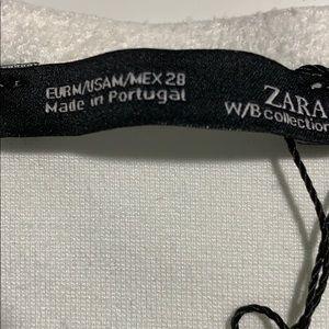 Zara Tops - NWT. Zara White with V-neckline. Size M